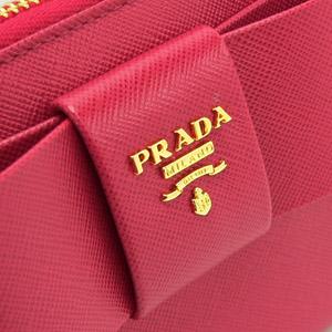 プラダ 長財布 PRADA プラダ 財布 ラウンドファスナー リボン サフィアーノ 型押しレザー ペオニア 1M0506 SAF.FIO