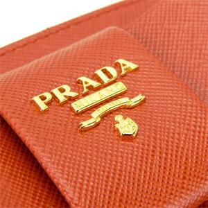 プラダ 長財布 PRADA プラダ 財布 ラウンドファスナー リボン 型押しレザー パパヤオレンジ 1M0506 SAFFIANO.FIOCCO